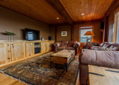 Wood entertainment center spanning the length of the room