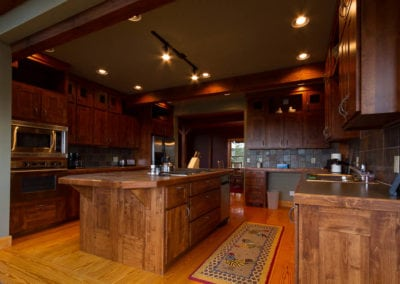 Custom kitchen with premium dark wood with custom tile work and recess lighting