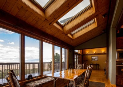 Gorgeous mountain views with natural and skylights in dining room