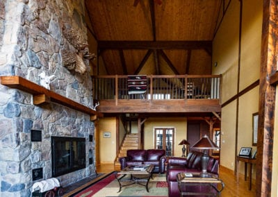 Huge stone fireplace to warm your living room with upper loft