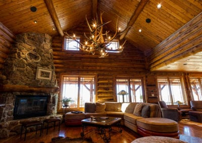 Log mountain home with custom elk antler chandelier
